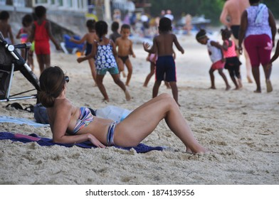 BEAU VALLON, MAHE, SEYCHELLES - February 3, 2017 : a seychellois kindergarten class on an excursion to the beau vallon beach with the quiet tourists