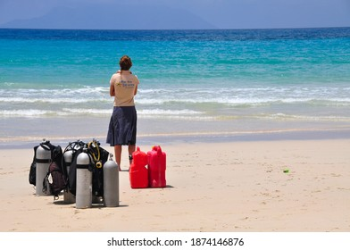 BEAU VALLON, MAHE, SEYCHELLES - February 3, 2017 : woman waits for the divers to return from the fish watching outing on the beautiful beach of beau vallon.
