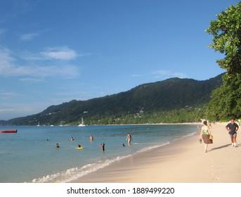Beau Vallon, Mahe, Seychelles - September 10 2011: Turists enjoys swimming in Indian ocean