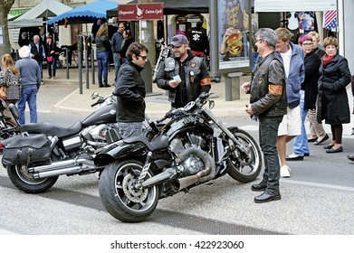 BEAUCAIRE, FRANCE - APRIL 30: Bikers in discussion with a gathering of American motorcycles in Beaucaire in the French department of Gard, april 30, 2016