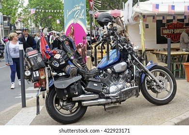 BEAUCAIRE, FRANCE - APRIL 30: A motorcycle covered with travel memories in a gathering of American motorcycles in Beaucaire in the French department of Gard, april 30, 2016