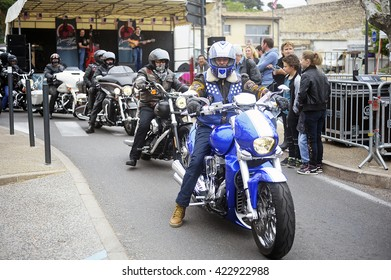 BEAUCAIRE, FRANCE - APRIL 30: Motorcyclists driving on the street in a gathering of American motorcycles in Beaucaire in the French department of Gard, april 30, 2016