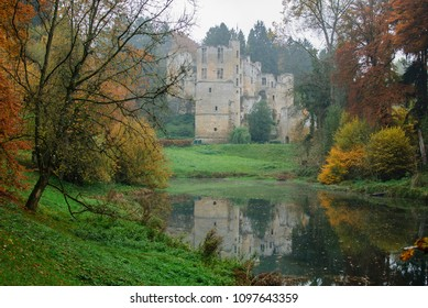 Beaufort, Luxembourg - October 28, 2015: View of Beaufort Castle from a foreground dam in autumn
