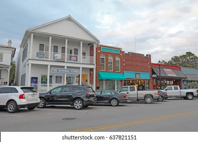 "BEAUFORT, NORTH CAROLINA - APRIL 18 2017: Businesses on Front Street in downtown Beaufort, the third-oldest town in the state, rated as ""America's Coolest Small Town"" by Budget Travel Magazine in 2012"