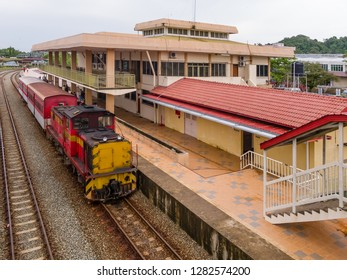 Beaufort, Sabah, Malaysia - November 17 2011: Diesel locomotive 6105 of Sabah State Railway at Beaufort Station enroute through the Padas River Valley