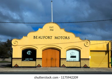 BEAUFORT, VICTORIA, AUSTRALIA - 07 AUGUST 2018: The fabulous, historic art deco building of Beaufort Motors standing stark against a dark and stormy sky.