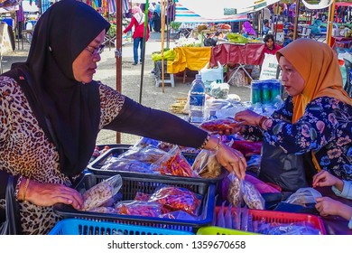 Beaufort,Sabah-Sept 1,2018:People buying the variety of delicious Malaysian home made cooked dishes at street market stall in Beaufort,Sabah Malaysia.It is a small town in southwestern Sabah,Malaysia.