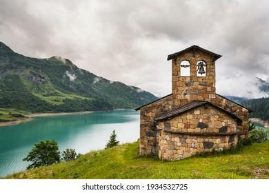 Beaufort-sur-Doron, France - July 6, 2008: Lac de Roselend. The chapel.
