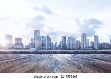 Beauitful roof top city view with sunlight and clouds in sky. Urban background concept