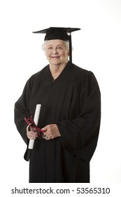 Beauitiful Caucasian Senior Citizen in a black graduation gown holding a diploma isolated on a white background