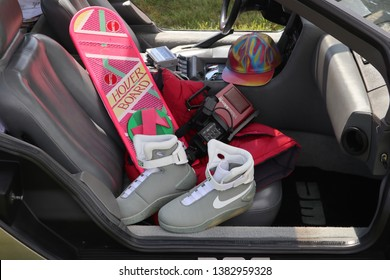 Beaulieu, Hampshire / UK - 08 05 2017: Sports and Classic event. Back to the Future II Props inside Delorian including Hover Board, Sony Video Camera / Camcorder, Sony Walkman, Nike Air MAG  Boots