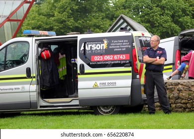 Beaulieu, Hampshire, UK - May 29 2017: Fire sniffer dog van and officer belonging to the Hampshire Arson Task Force
