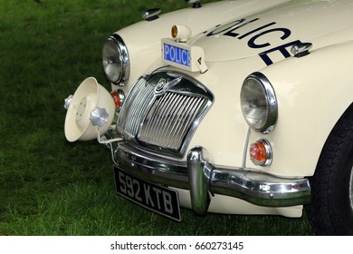 Beaulieu, Hampshire, UK - May 29 2017: Nice image of a classic vintage MGA roadster in UK Police livery showing detail of front grille, headlights and POLICE emblem
