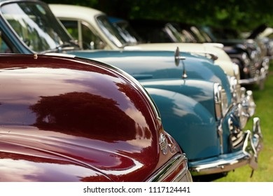 BEAULIEU, HAMPSHIRE, UNITED KINGDOM - May 20, 2018, Morris Minor day with many varieties of Morris Minors all parked in a row on the grass with selective focus.