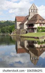 Beaulieu sur Dordogne and the chapel of Penitents along the Dordogne river, France