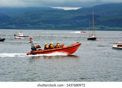 Beaumaris Atlantic 85 class lifeboat leaving the shore in Beaumaris on lifeboat day on Anglesey in North Wales returning to shore on 2 June 2018