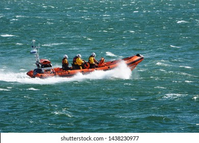Beaumaris Atlantic 85 class lifeboat out on training exercise in windy weather  in the Menai Strait of the coast of Anglesey in North Wales on 11th September 2016