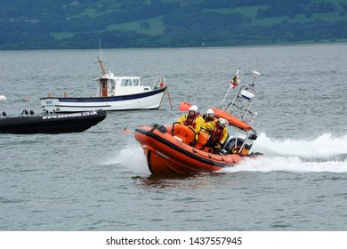 Beaumaris Lifeboat on lifeboat day on Anglesey in North Wales returning to shore on 2 June 2018