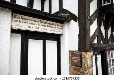Beaumaris, Wales - September 2nd 2020: Plaque above the entrance to one of the oldest buildings in the UK - built in around 1400, its located in Beaumaris on the Isle of Anglesey in Wales, UK.
