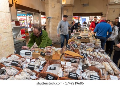 Beaune / France - April 29, 2017: Merchants selling charcuterie and cheese at the Saturday market in Beaune, France.