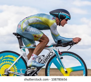 BEAUROUVRE,FRANCE,J UL 21:Vinokourov Alexandr, the winner of the gold in the Olympic Men's Road Race in London, pedaling in the 19 time trial stage of Le Tour de France on July 21 2012.