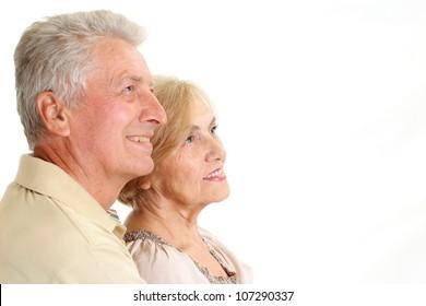 Beauteous elderly couple on a white background