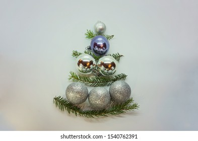 A beautful conceptual Christmas tree made from baubles and decorated by spruce branches. Inversive Xmas tree