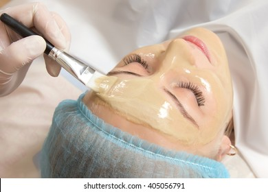 beautician applied with a brush to the face mask in a beauty salon