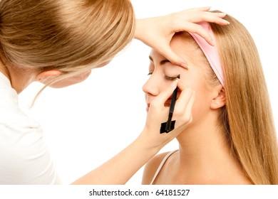 Beautician Applying Woman's Make Up