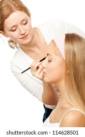 Beautician Applying Woman's Make Up.Isolated on white