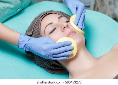 beautician cleanses skin woman with sponge. Perfect cleaning - c