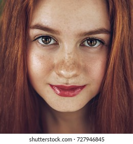 Beautician freckles teenager portrait with healthy skin and red hair,foxy hair, ginger girl,Eyes face
