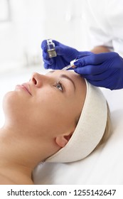 At the beautician. Healthy skin rejuvenating treatment using vitamin ampoule