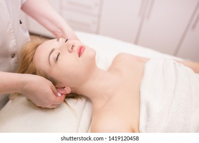 Beautician makes facial massage girl. Lymphatic drainage massage LPG, apparatus process. Beauty treatments at the beauty salon SPA. Liquefied gas and contour treatment of the face and body. Skin care.