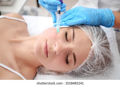 Beautician making injection in woman's face, closeup. Biorevitalization procedure