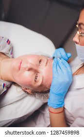 Beautician making injection in woman's face, closeup. Biorevitalization procedure.