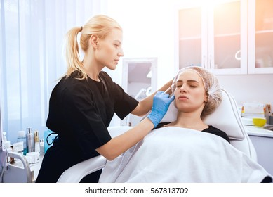 Beautician and the patient in the clinic of aesthetic medicine. The injection.