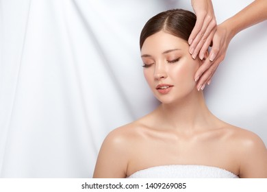 beautician touching woman's face, spa treatment for young and beautiful girl, perfect skin treatment, lovely client of salon