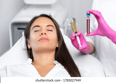 Beautician will do PRP therapy for the face against wrinkles and against hair loss of a beautiful woman in beauty salon.Doctor holds test tubes with venous blood and blood plasma.Cosmetology concept.