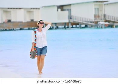 beautifel and happy woman girl on beach have fun and relax on summer vacation  over the beautiful tropical sea