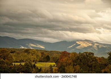 The beautifful Appalachian mountains in West Virginia  during autumn colors as the sun highlitghs the clouds.