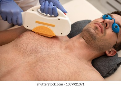 beautification of male have laser epilation on man's chest in cosmetic salon