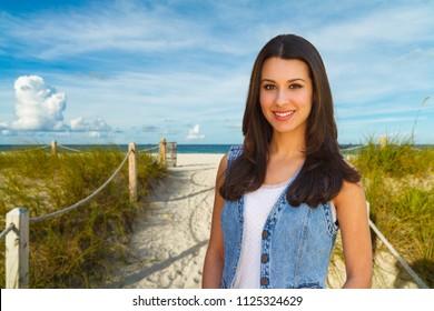 Beautifiul young woman outdoor portrait enjoying the beach.