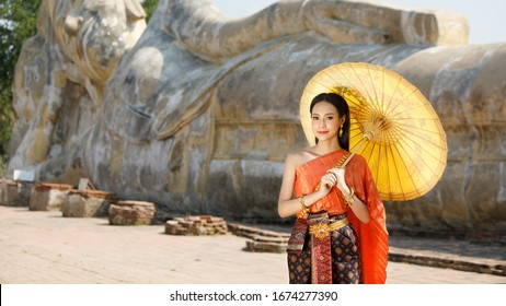 Beautifli thai woman in thai traditional costume holding umbrella  in Ayutthaya,Thailand