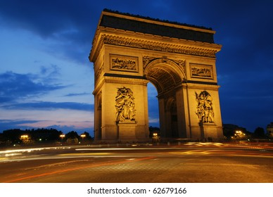 Beautifluly lit Triumph Arch at night. Paris, France.