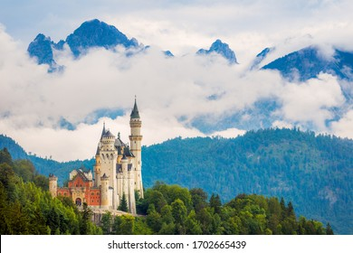 Beautifu mistyl view of world-famous Neuschwanstein Castle, the nineteenth-century Romanesque Revival palace built for King Ludwig II on a rugged cliff near Fussen, southwest Bavaria, Germany