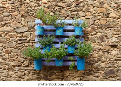 Beautifuful flowerpot recycling on a stone wall