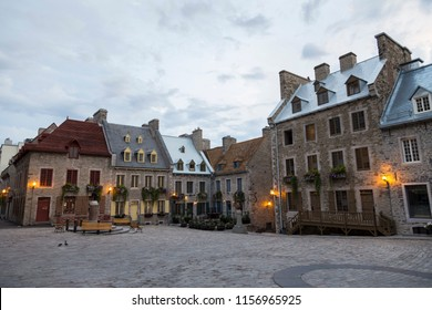 Beautiful 17th Century patrimonial stone houses with pitched metal or shingled roofs on Place Royale in the old part of Quebec City in the early morning light in summer, Quebec, Canada