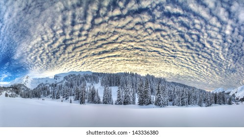 Beautiful 180 degree HDR panorama in the European Alps with a fantastic cloudscape