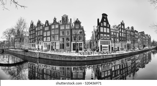 Beautiful 180 degree panorama at the famous UNESCO world heritage canals of Amsterdam, the Netherlands, in black and white.